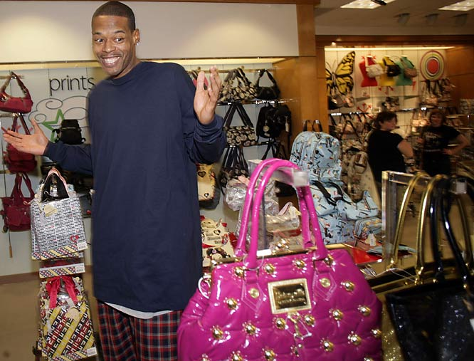 Marcus Camby just can't decide on the right handbag.