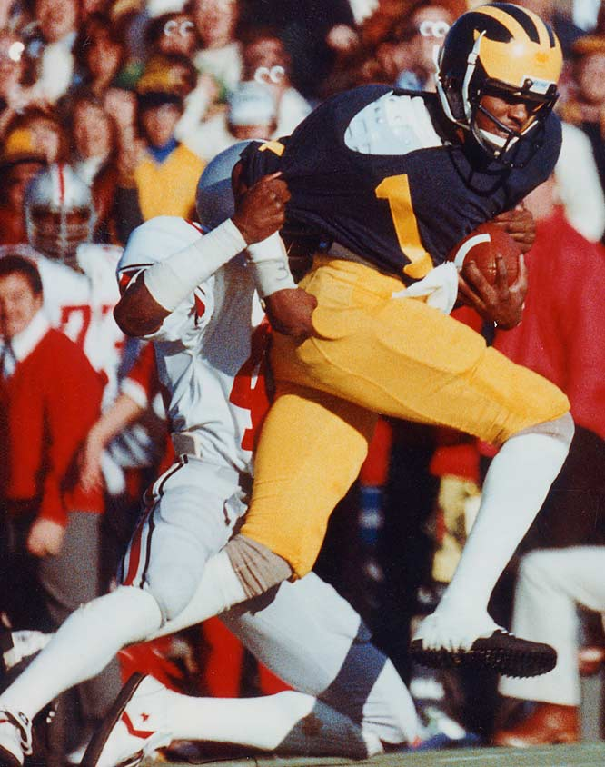 The most exciting football player I've ever seen. That's how Michigan coach Lloyd Carr, then an assistant for Bo Schembechler, described the three-time All-America wideout. Carter was a touchdown-making machine for the Wolverines (he had 36 in his career) and finished in the top 10 in the Heisman Trophy voting his final three seasons.<br><br>Runner-up: <br>Ernie Nevers, FB, Stanford (1923-25)