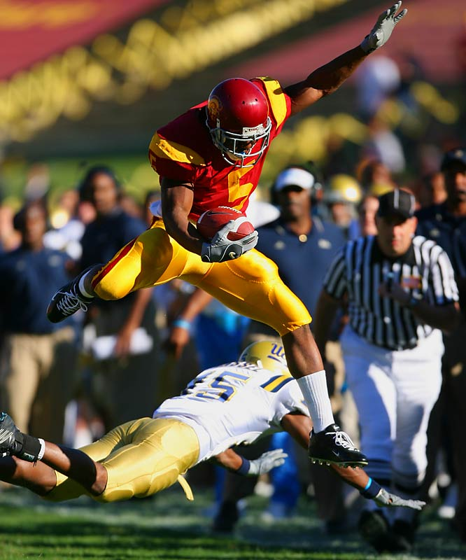 An electrifying open-field runner, Bush won the Heisman Trophy in 2005 by averaging 8.7 yards per carry (200 carries for 1,740 yards) and scoring 16 touchdowns. He ranks 10th in NCAA Division I-A history with 6,551 all-purpose yards. <br><br>Runner-up: <br>Paul Hornung, QB, Notre Dame (1954-56)