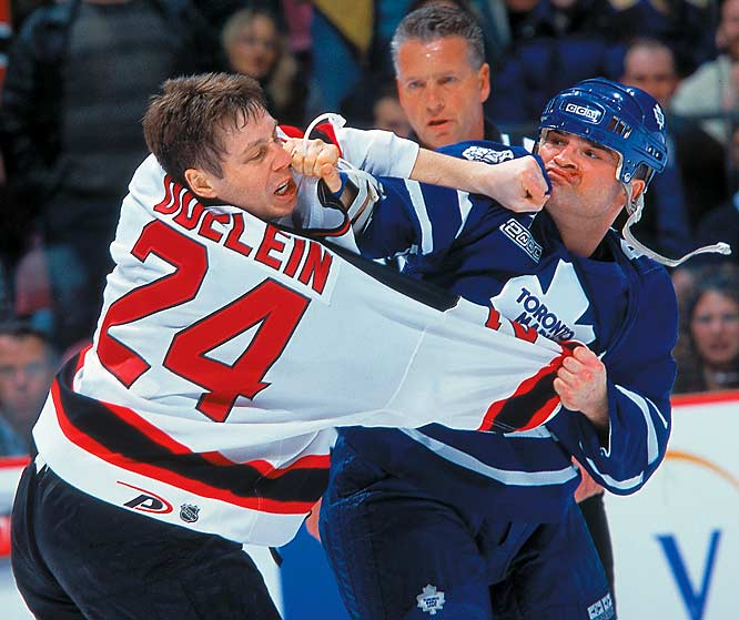 Notorious NHL fighter Tie Domi, then with the Toronto Maple Leafs, squares off with New Jersey's Lyle Odelein during a regular season match in February 2000.