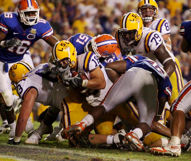 LSU coach Les Miles' gambler reputation paid off with a pair of fourth-quarter touchdowns, including Jacob Hester's two-yard score with 1:09 to play, giving LSU a 28-24 win over Florida.