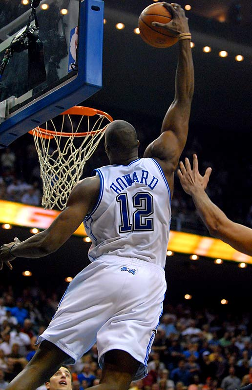 The first game winning-basket of Dwight Howard's career makes for a nice poster. The Magic forward soared high above Spurs forward Tim Duncan, grabbed a long inbounds pass from Hedo Turkoglu with one hand, and dunked it with 0.2 seconds left. The flush gave Orlando a 106-104 victory. Howard finished with 30 points and blocked a shot by Spurs guard Tony Parker with 0.8 seconds left to set up the game-winning play.
