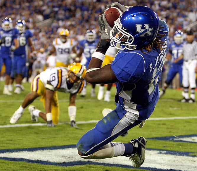 A No. 1 hadn't fallen during the regular season since Kansas State beat Oklahoma on Dec. 6, 2003, but Kentucky changed all that with a 43-37 triple-overtime win. Steve Johnson caught the game-winning seven-yard touchdown pass, and the defense held on fourth-and-2, giving UK its first victory over a top-ranked team in 43 years.