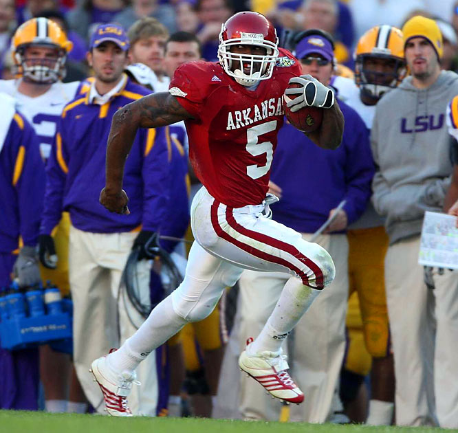 Arkansas running back Darren McFadden ran for 206 yards and three touchdowns and threw for another as LSU lost as a No. 1 for the second time, this one 50-48 in triple overtime.
