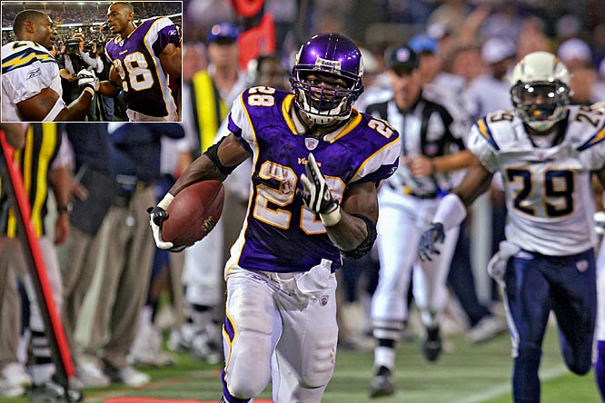 "It took just eight games for Adrian Peterson to shatter one of the NFL's most cherished records. The Vikings rookie running back set the NFL's single-game rushing record of 296 yards on Nov. 4, leading Minnesota to a 35-17 victory over the Chargers. (Left, Peterson is congratulated by Chargers star LaDainian Tomlinson). Peterson topped Jamal Lewis' 295-yard performance against Cleveland in 2003 for the best game a running back has ever had in the NFL. ""I was out playing ball,"" Peterson said. ""I wasn't thinking about the record at all."""