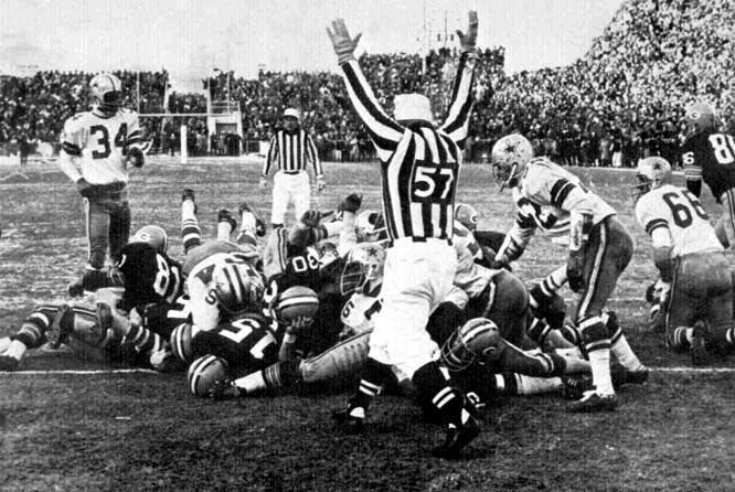 """Lambeau Field played host the coldest NFL game on record when the Packers and Cowboys met on New Year's Eve for a trip to Super Bowl II. The Cowboys took a 17-14 lead with five minutes remaining on a trick halfback pass. After the Packers took over on their own 32, aging signal-caller Bart Starr completed 5-of-5 passes while driving the hosts to the Dallas 1. With 16 seconds left, Starr dove into the end zone on a quarterback sneak -- on a play known as """"31 Wedge"""" -- to lock down Green Bay's fifth championship in seven years."""
