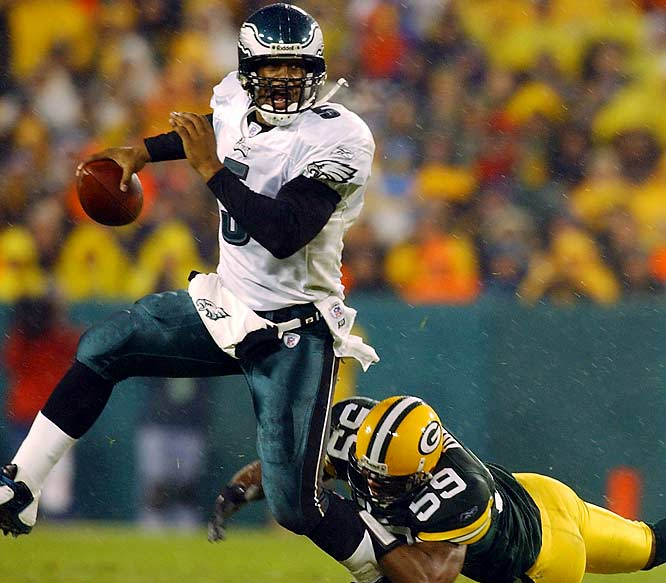 "With 2:20 remaining and the Eagles trailing 17-14 on their own 20, Donovan McNabb engineered a dramatic drive downfield -- including a miraculous first down completion to Freddie Mitchell on 4th-and-26 -- to set up the game-tying field goal. After David Akers won the game in overtime, Mitchell's emphatic press conference opener induced chills throughout title-starved Philadelphia: ""We don't need fate. We have [No.] 5."""