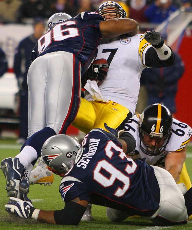 Pats' linebacker Adalius Thomas sacks quarterback Ben Roethlisberger late in the game.