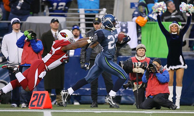 Seahawks cornerback Marcus Trufant returns the second of his three picks in the game 84 yards for a touchdown.