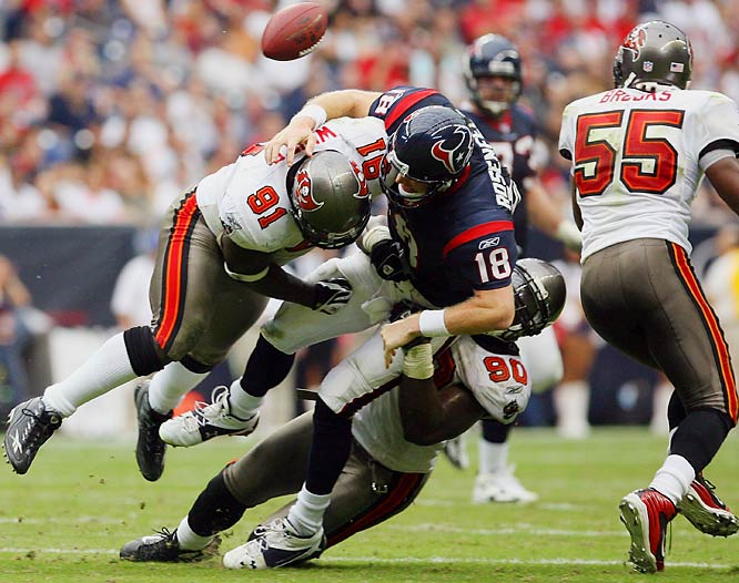 Bucs' defensive end Greg White (91) sacks quarterback Sage Rosenfels, forcing him to fumble.  White sacked Rosenfels three times and forced him to fumble twice, both recovered by Bucs' defensive end Jovan Haye.