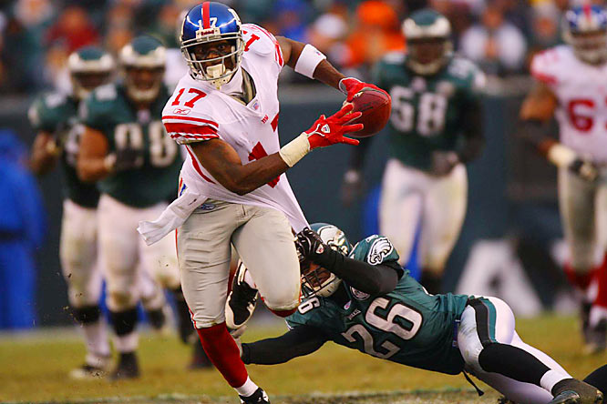 Plaxico Burress caught seven passes for 136 yards and a touchdown against the Eagles, despite leaving pregame warm-ups early with an ongoing ankle injury.