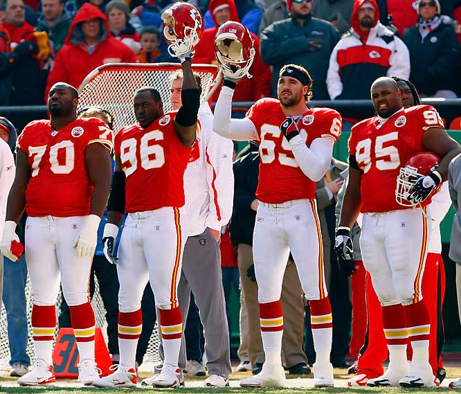 Chiefs' defensive ends Jimmy Wilkerson (96) and Jared Allen (69) raise their helmets during a moment of silence in their game with the Chargers.