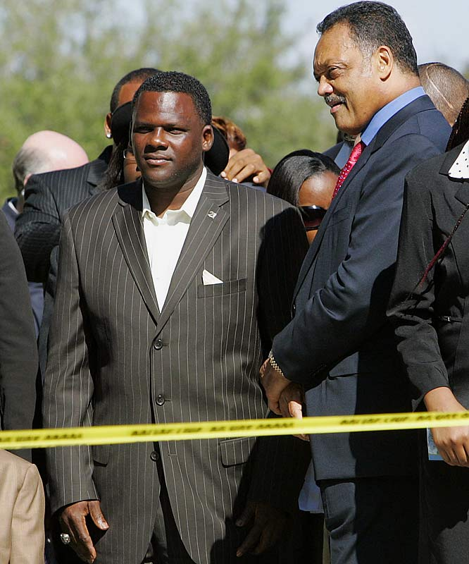 Sean's father Pedro Taylor, left, talks with the Rev. Jesse Jackson as they arrive for the funeral.