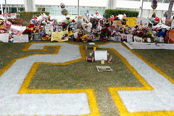 Items are left at the memorial for Taylor outside FedEx field.