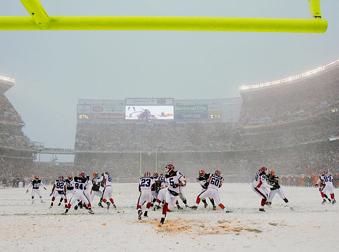 With wind gusts up to 40 mph and visibility limited, throwing the ball was nearly impossible and both teams had to rely on their running games. But even that was tough as players struggled to get traction on the slippery, snow-covered surface.