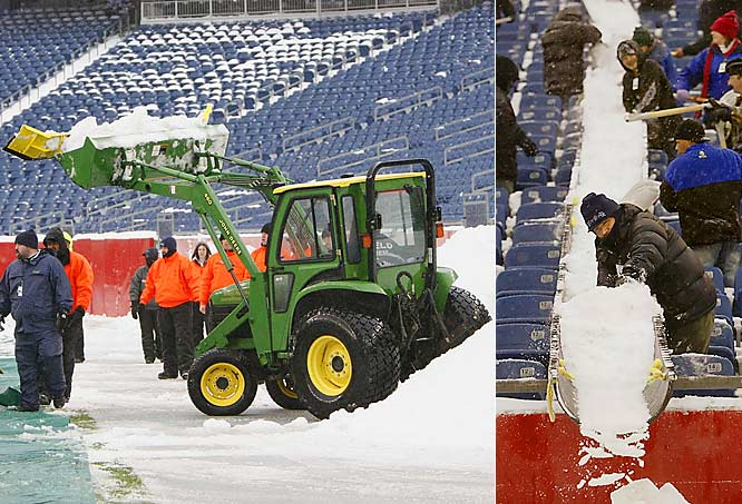Approximately six inches of snow blanketed the tarp-covered field in the early-morning hours. Plows were on the field six hours before the game to shovel away the snow.