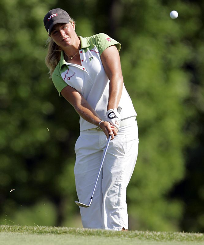 Suzann Pettersen of Norway recovered from a 2005 back injury that doctors feared might end her career to win her first major by one-stroke over Karrie Webb.