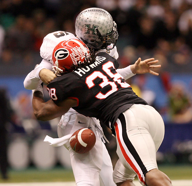 Georgia's feisty defense terrorized Heisman finalist Colt Brennan, sacking the QB eight times and intercepting three of his passes. Bulldogs freshman sensation Knowshon Moreno had two rushing touchdowns.