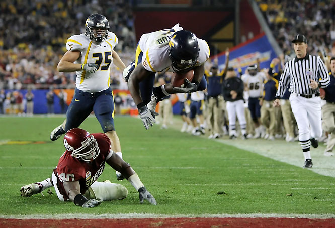 In quite possibly the most shocking result of this bowl season, the Mountaineers ran wild on a vaunted Oklahoma front, amassing 349 yards on the ground. Playing without Rich Rodriguez for the first time in his career, West Virginia QB Pat White threw for 176 yards and two touchdowns and ran for an additional 150 yards.