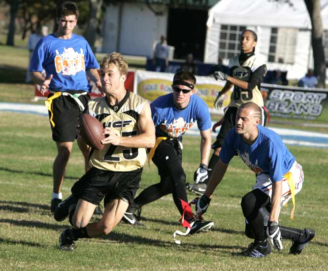 A Central Florida player avoids a group of Florida defenders in the men's championship game. Florida would go on to win, 26-21.