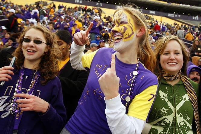 LSU fans cheer on the football squad during the team's championship celebration in Baton Rouge.