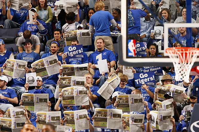 Memphis fans take a second to catch up on the news during the introduction of Gonzaga's starting lineup.