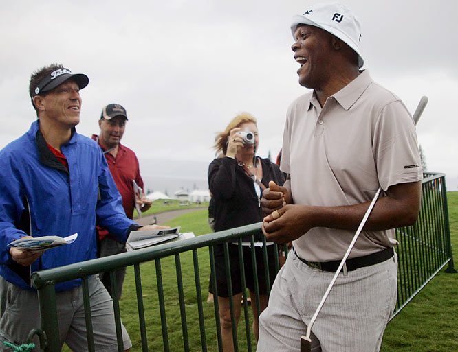 Samuel L. Jackson laughs while signing autographs during the Pro-Am round of the Mercedes Benz Championship golf tournament in Hawaii on Jan. 2.  He was probably asking where to find the nearest Big Kahuna Burger.