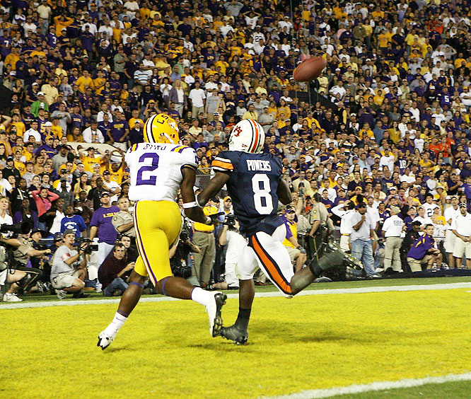 With LSU trailing 24-23 and seconds to play, Les Miles decided to run one more play before trying a game-winning field goal. Matt Flynn connected with Demetrius Byrd for a 22-yard touchdown (pictured) with just a second to spare.