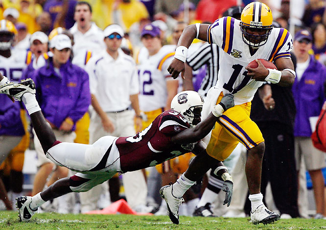 The Gamecocks provided LSU with its first test of the season. In the play of the game, LSU K Colt David scored a 15-yard touchdown on a nifty fake field goal. Holder Matt Flynn received the snap then flipped a no-look, over-the-shoulder toss to David, who easily scampered into the end zone.