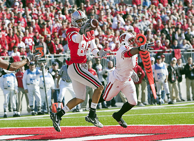 Wisconsin held a 17-10 lead in the third quarter, but then Beanie Wells took the game over. While Ohio State's defense locked down, Wells ran for three second-half scores to guide the Buckeyes to victory.