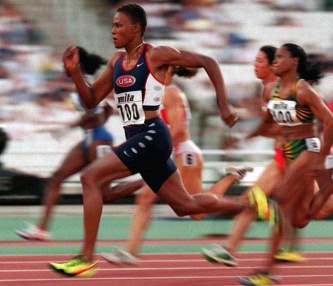 Forced to miss the Atlanta Olympics because of an injury first suffered on a basketball court at the World University Games, she gives up basketball and focuses on track and field, taking gold in the 100 at the World Championships in Athens.