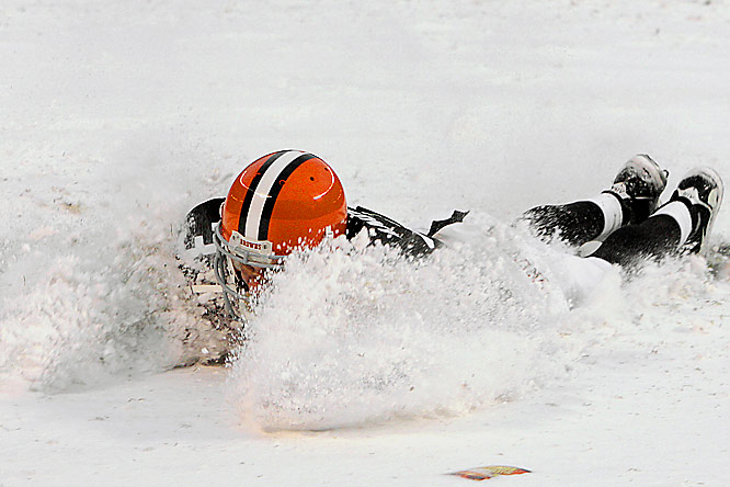 Browns quarterback Derek Anderson celebrates his team's win in the NFL's first 8-0 game since 1929 by diving through the snow in the end zone.