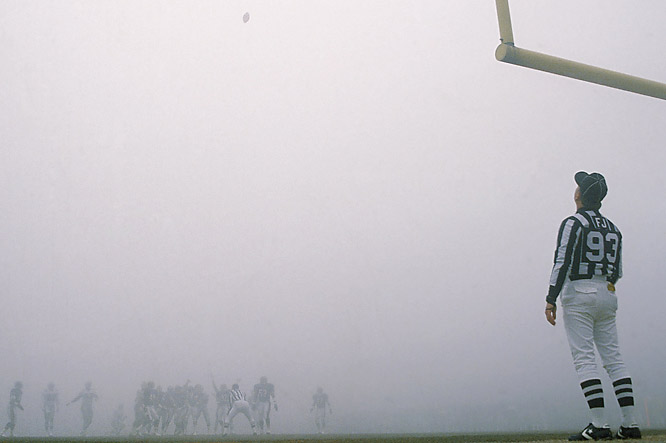 With temperatures in the low 30s, a fog rolled in off Lake Michigan near the end of the first half. The field shrouded, the Bears passed only seven times as players and coaches struggled to see the action. When the fog finally lifted, the Bears had downed the Eagles 20-12.