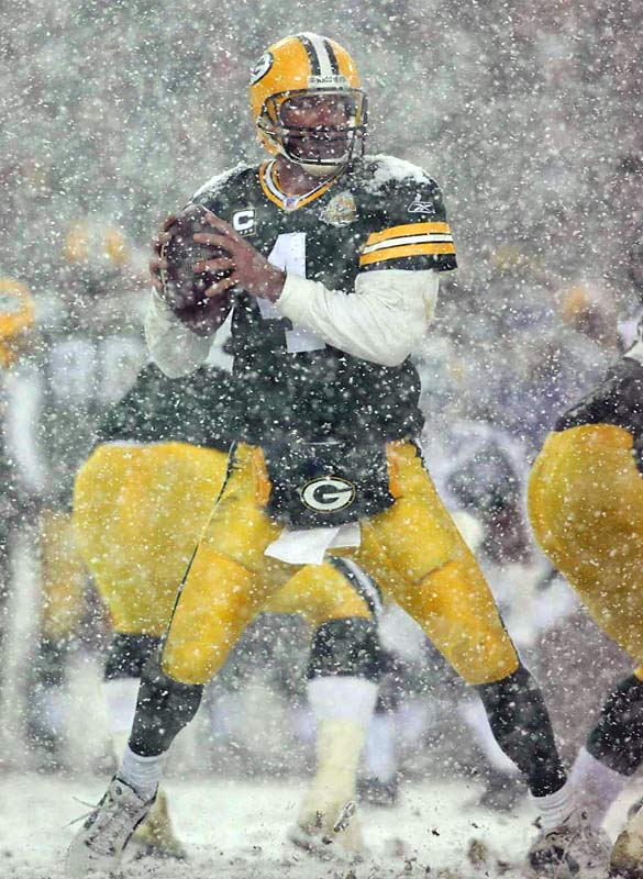Packers quarterback Brett Favre peers through typical Green Bay weather in search of an open receiver against the visiting Seattle Seahawks. Favre threw for 173 yards and three TDs in the game.