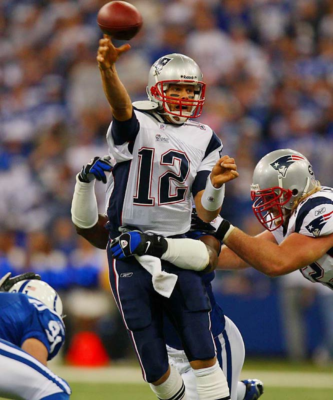 Tom Brady under pressure by Dwight Freeney.