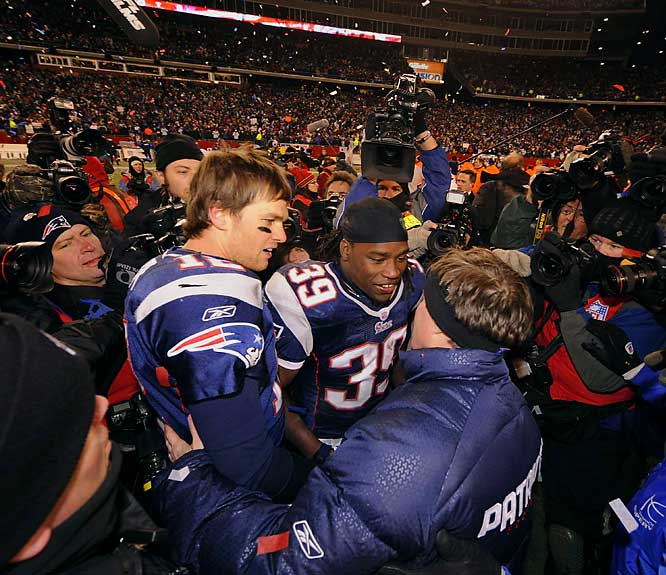 Tom Brady and Laurence Maroney receiving accolades from coach Bill Belichick after their victory sent them to the Super Bowl.