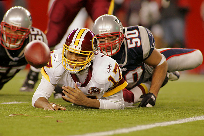 Mike Vrabel forcing one of three fumbles by Jason Campbell.