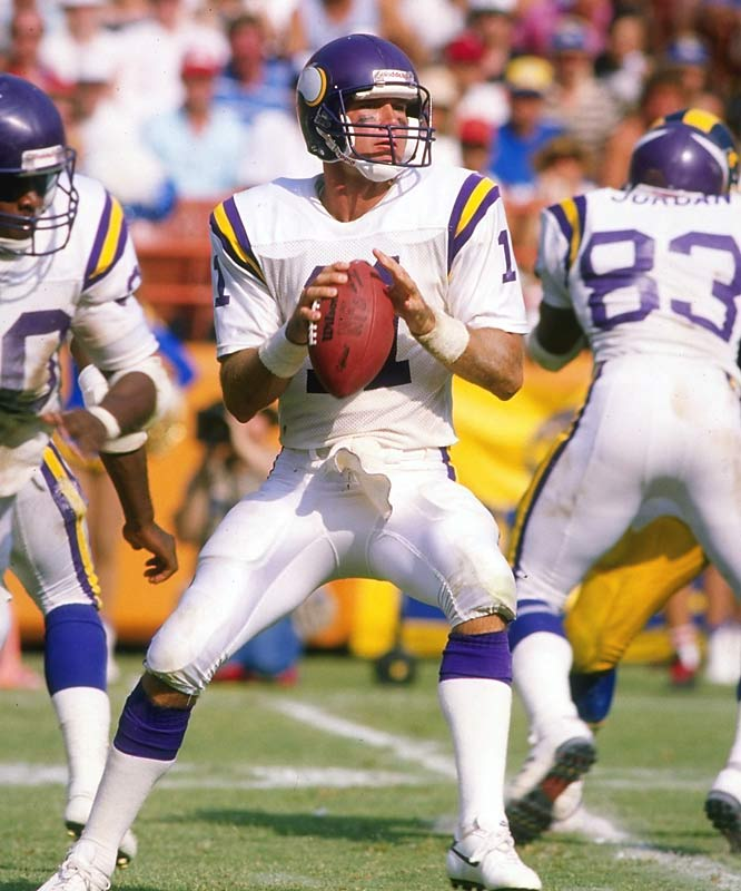 Wilson passed for 298 yards and a pair of touchdowns as the Vikings stunned the 49ers, who had stormed into postseason with the league's best record. Minnesota sprinted to a 20-3 halftime lead and never looked back. Wilson's biggest benefactor was wideout Anthony Carter, who caught 10 balls for a playoff-record 227 yards on the soggy Candlestick Park turf. How desperate did the Niners get? Bill Walsh benched Joe Montana -- for the first time in nine years -- midway through the third quarter.