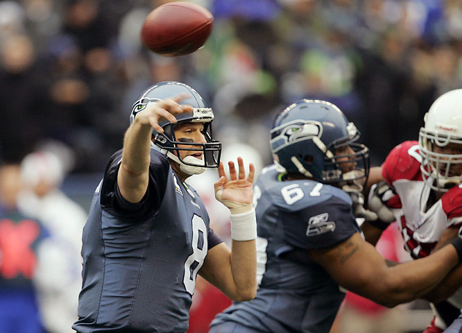 Seattle's three-time Pro Bowl QB connected for touchdown passes with Nate Burleson, Bobby Engram, Deion Branch and Marcus Pollard as the Seahawks doubled up the Cardinals to lock down their fourth consecutive NFC West crown.