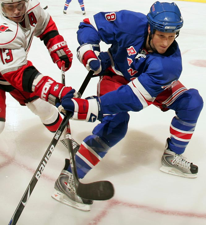"The middle member of the NHL's trio of Staal brothers, Marc, 21, was drafted 12th overall by the Rangers in 2005 and has been a coolheaded presence on their backline, posting over 18 minutes per game and a plus-6 in 51 matches. A fine skater with size (6'4"", 205) and reach, he earned an Eastern YoungStars roster spot and has invited Calder contender talk."