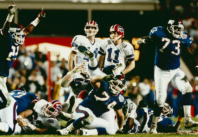 "Trailing 20-19 with 2:16 to play in a gut-grinding game, the Bills drove from their own 10 to the Giants' 29. Quarterback Jim Kelly spiked the ball with eight seconds left, and both teams prayed as Scott Norwood attempted the game-winning 47-yard field goal. ""I hit it solid, but I guess I tried to kick it too hard,"" he later said."