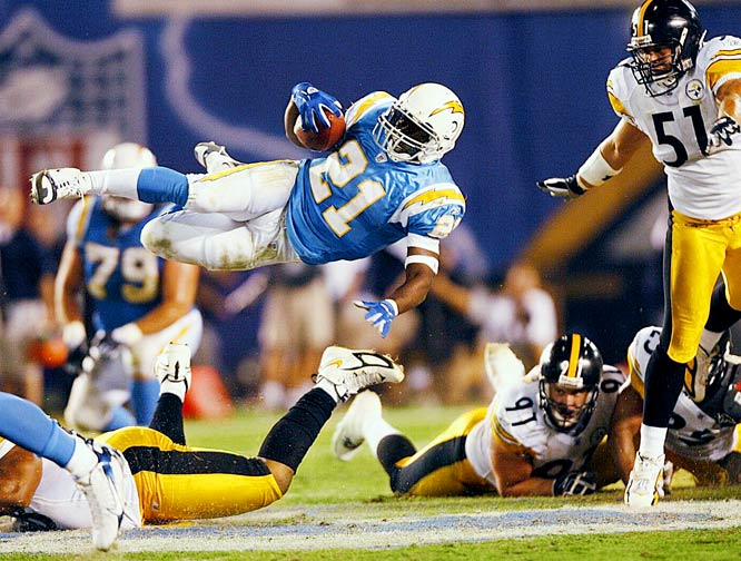 LT went airborne to gain a few extra yards in this 2006 regular season Monday nighter against the Pittsburgh Steelers. It is the type of shot football shooters dream about. Big talent in a big game getting big air.