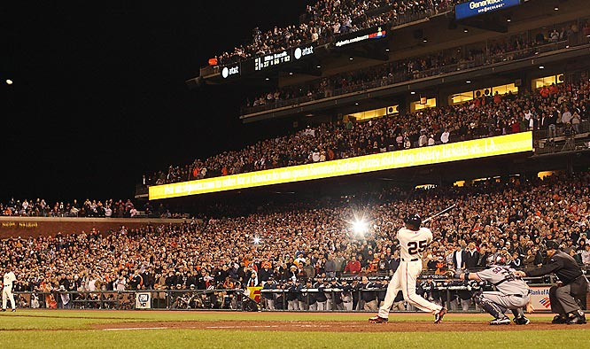 I was one of several shooters for SI to cover Barry Bonds' chase for the home run record. Whether you love him or hate him, it was quite a spectacle. Everyday the stadium was packed with fans in anticipation of witnessing history. This night they did. My assistant and I arrived four hours early to set up 5-7 remotes to catch various angles of the record breaker. I made this image of No. 756 with a 50mm lens on a remote camera just up the third base line. It shows all of the fans down the right field line on their feet. The faces are tack sharp. A single asterisk from the stands highlights the ball.