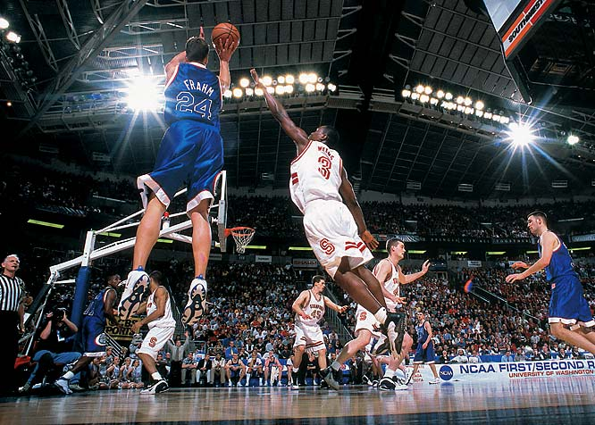 Beck's take:<br><br>This is my favorite basketball shot. I used a remote camera placed at the side of the court to catch Richie Frahm of Gonzaga launch a trey against Stanford in the second round of the 1999 NCAA tournament. Gonzaga Coach Mark Few once told me it was his favorite picture because it shows how pure Frahm's technique was. I love the compostion and feel.