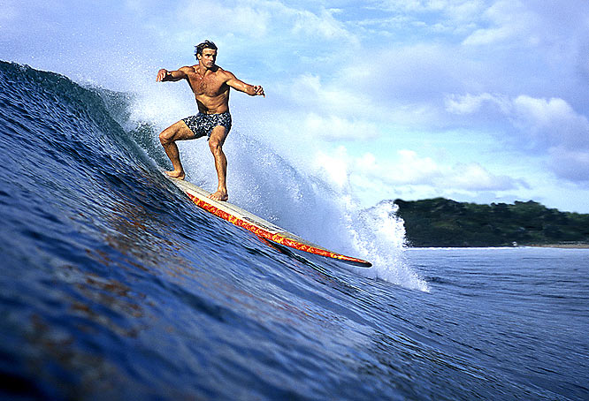 I cut my photo teeth working at Surfer Magazine in the eighties. There is nothing better than loading the camera in a waterproof housing and shooting some good surf action from the water. Here I have captured surfing's king, Laird Hamilton, on a playful day at Hanalei Bay near his home on Kauai. Laird, like all true great athletes, makes everything he does look so easy.