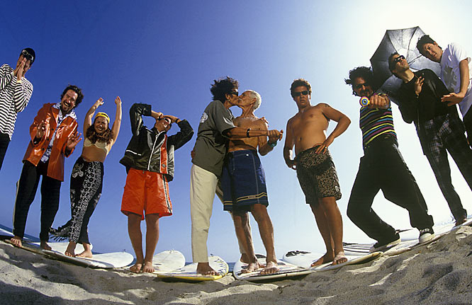 """This portrait of the famous surfing Paskowitz family was shot in San Clemente and brings out the personality of each family member and there is a LOT of personality in that group. It begins with the love Dorian and Julliette have for each other. Dorian, better known as """"Doc"""" in surfing circles, and Julliette began their brood in a camper and many of the kids were raised in a not-so-modern nomadic style that was the recent subject of a film. Each of the children (notice there is only one daughter, Nava) have followed their own path through life from a college football player to starting a very successful sunglass company to, of course, professional surfer. Please do not ask me to name all of them. Let's see ... Izzy, Jonathon, Abraham, Salvador, David, Joshua ... uuuummm."""