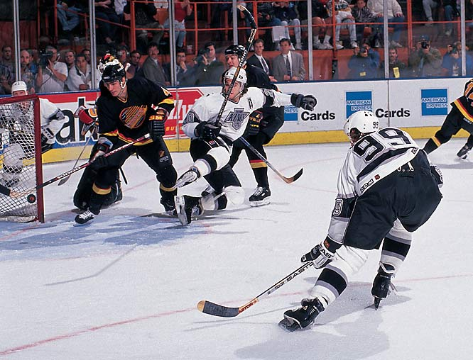 I followed Wayne Gretzky during his chase for record goal No. 802. It was the best of days for the Los Angeles Kings and one of the most enjoyable times of my photo career. Gretz was an amazing player and an even better person. Most of the NHL guys are great to work with. Here I captured Wayne scoring his record-setting goal with my handheld camera tethered to a set of four 2400-watt strobes in the arena catwalk. My timing had to be good, as I had to wait three seconds after every shot for the strobes to recycle before I could shoot another shot. Wayne had skated down my side of the boards and received a cross-ice pass from Marty McSorley (behind the net here). He skated in on a near-empty goal (notice the goalie out of position) and flipped it in past a helpless defender. Three seconds later I was shooting the new NHL goal scoring leader jumping for joy in front of 16,000 fans.