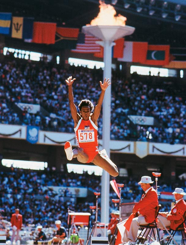 The six-time Olympic medalist (three gold, one silver, two bronze) owns the record in the heptathlon and long jump, and was voted by SI as the greatest female athlete of the 20th century.