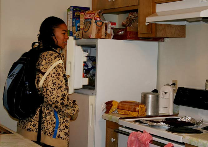 "Ashley's best friend is Cal sophomore point guard Natasha Vital, who came over toward the end of our visit. ""Tasha comes over for food that my mom buys just for her, like pizza pockets and chocolate milk,"" Ashley says. Here Vital -- who also has her own hot sauce cabinet -- inspects the freezer for new additions."
