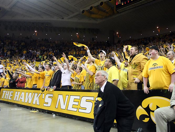 Iowa fans in the Hawkeye student section try to distract a Wisconsin player during the second half of Wisconsin's 60-54 win over Iowa.